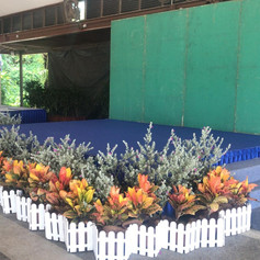 Stage with backdrop and flowers.jpg