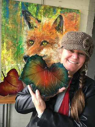 Deb Williams displays glass sycamore leaf