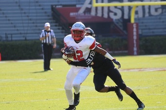 Former South Pointe wide receiver Scot Robinson carries the ball down the field during the second quarter, a play whose momentum carried throughout the rest of the game against Hartsville.