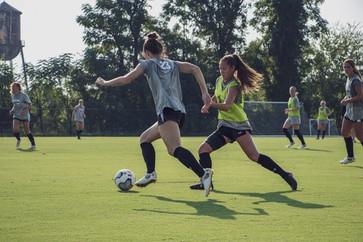 Midfielder Samatha Chang practicing with her teammate mid 2019 season.