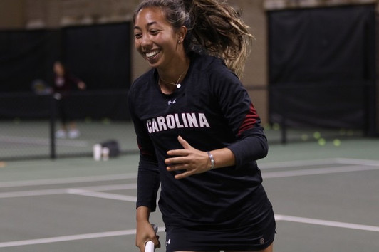 South Carolina tennis player Mia Horvit runs off the court with a smile at the Tennis Center in Columbia, SC.