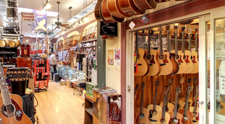 Inside Haight Ashbury Music Center - rows of guitars.