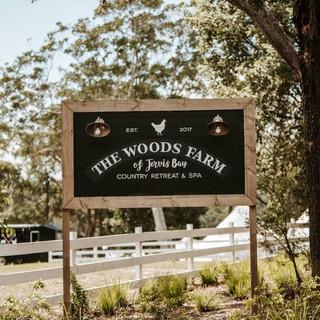 The Woods Farm logo &. branding