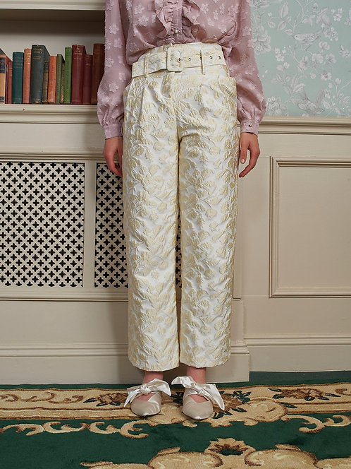 Cream jacquard trousers with matching fabric belt.