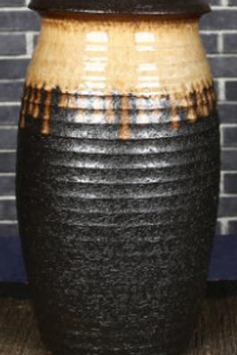 Layered lanternesque clay vase