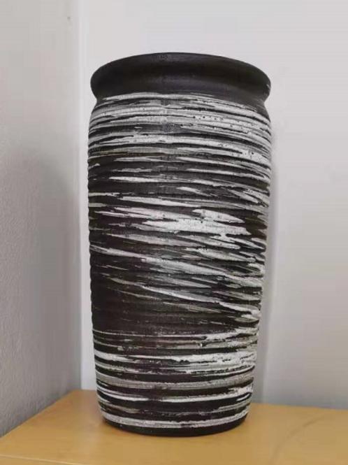 White spiral pattern porous clay vase