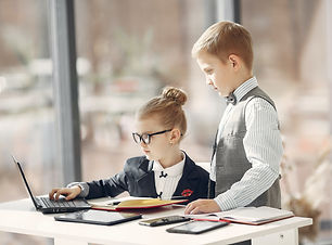 cute-business-kids-working-on-project-to