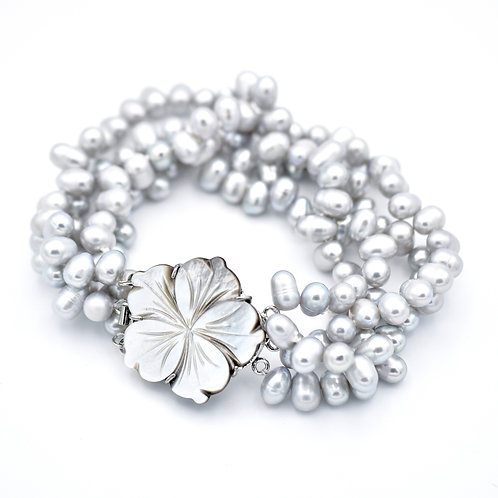 FOUR STRAND GRAY BAROQUE PEARLS W/ MOTHER OF PEARL CLOSURE BRACELET
