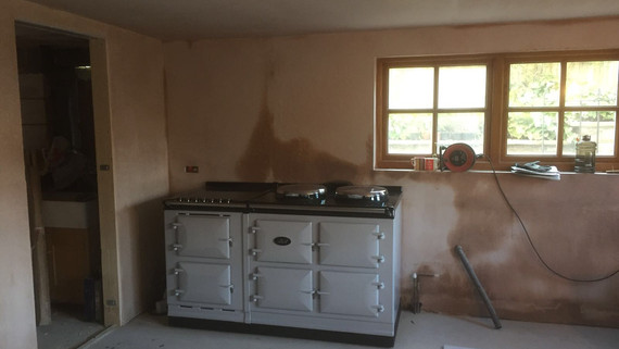 Kitchen with range and new plastered walls