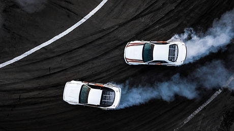 Aerial top view two car drift battle on