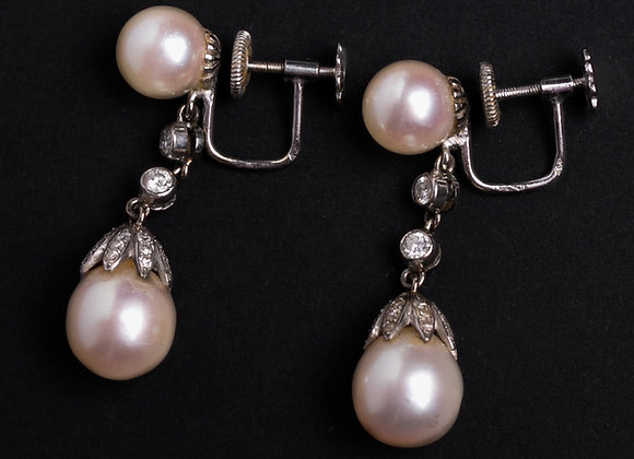 Boucles jeune fille diaphane or gris perles de culture et diamants face