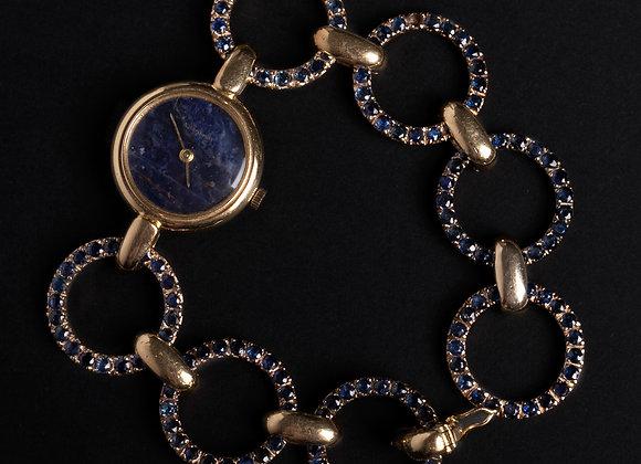 Montre bracelet nuit étoilée or jaune et saphirs entier