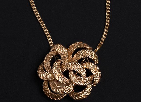 Broche pendentif Boucheron fleur tourmentée or jaune face
