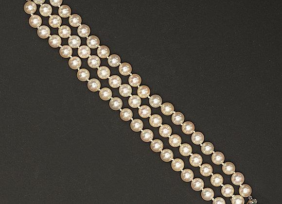 """Bracelet de perles choker, or gris, émeraudes et diamants """"Subtiles pétales"""""""