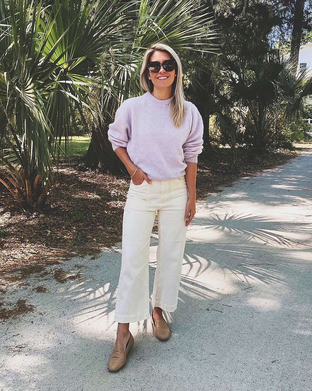 megan stokes in charleston wearing sweater and white jeans