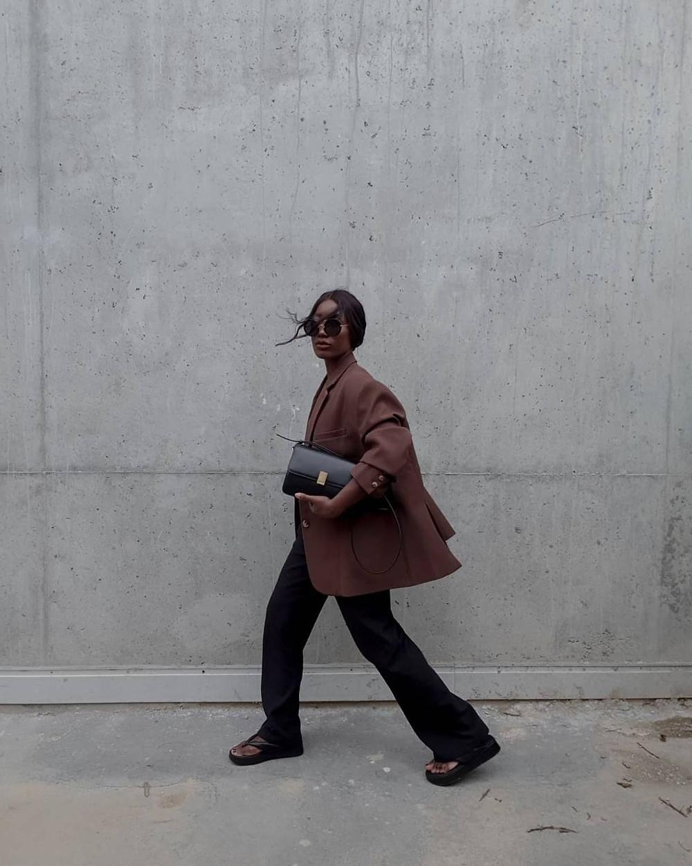woman in blazer and slacks