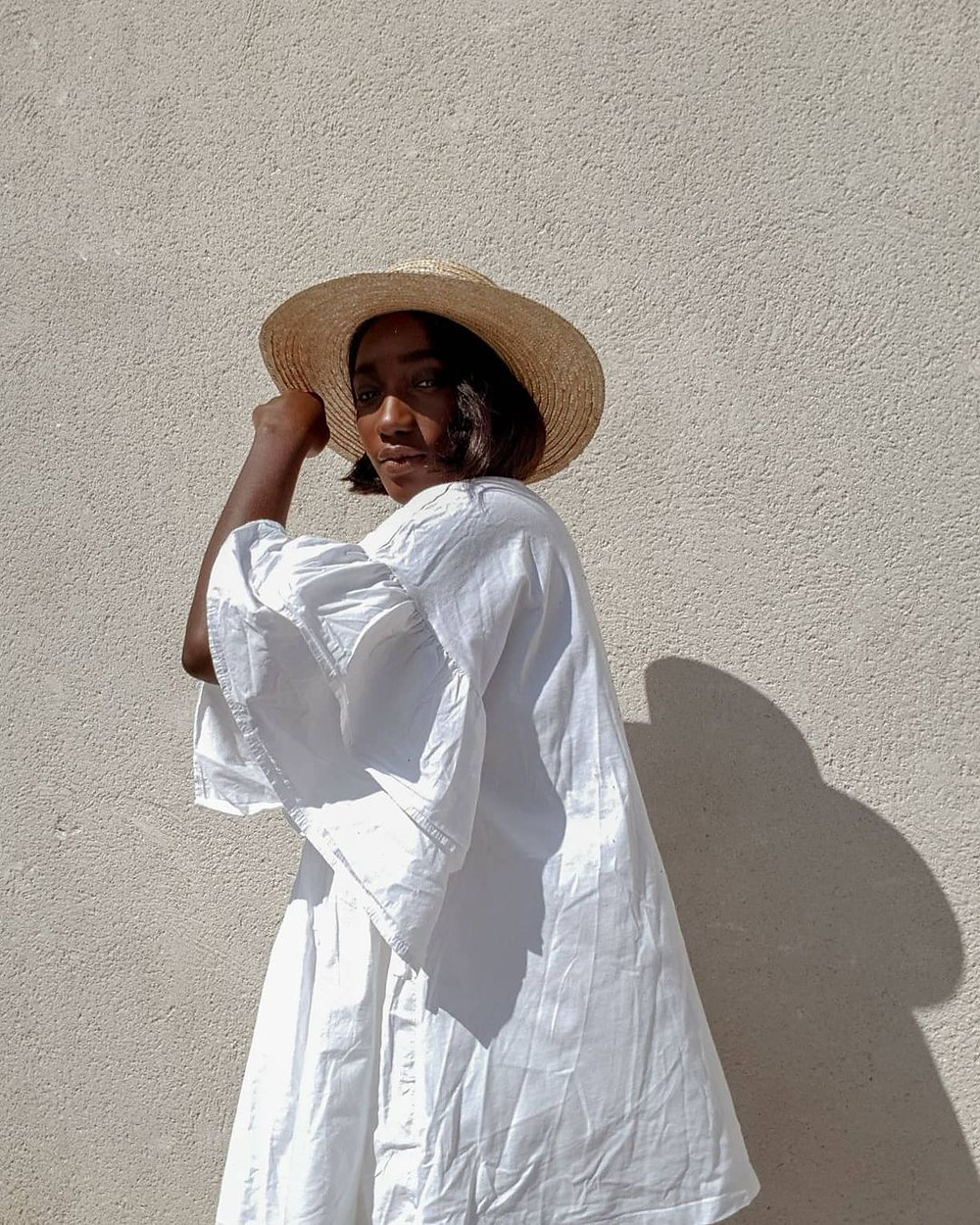 woman wearing white dress and straw hat