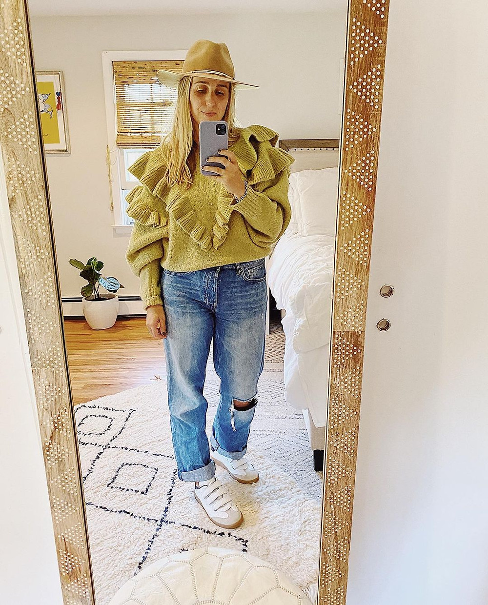 cooper mcmanus wearing a travel outfit and hat