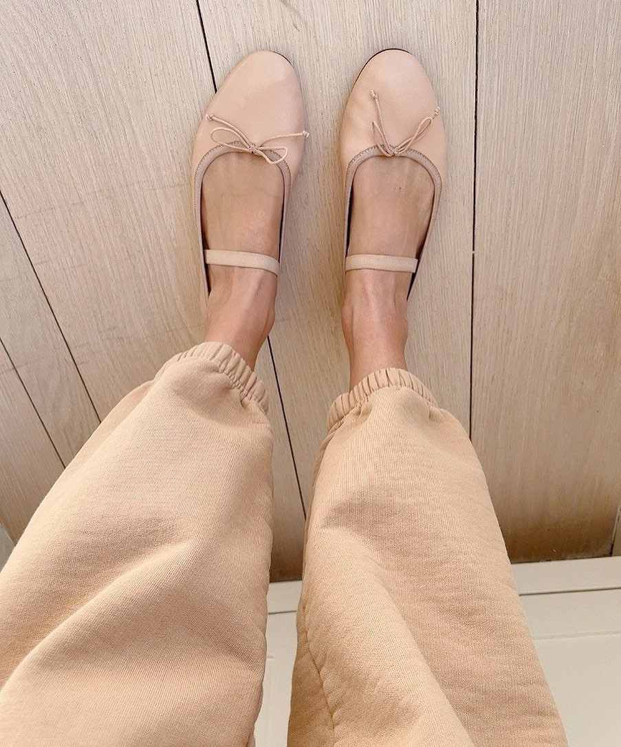 woman wearing Loeffler Randall Flats in nude pink with matching sweatpants in matching nude pink
