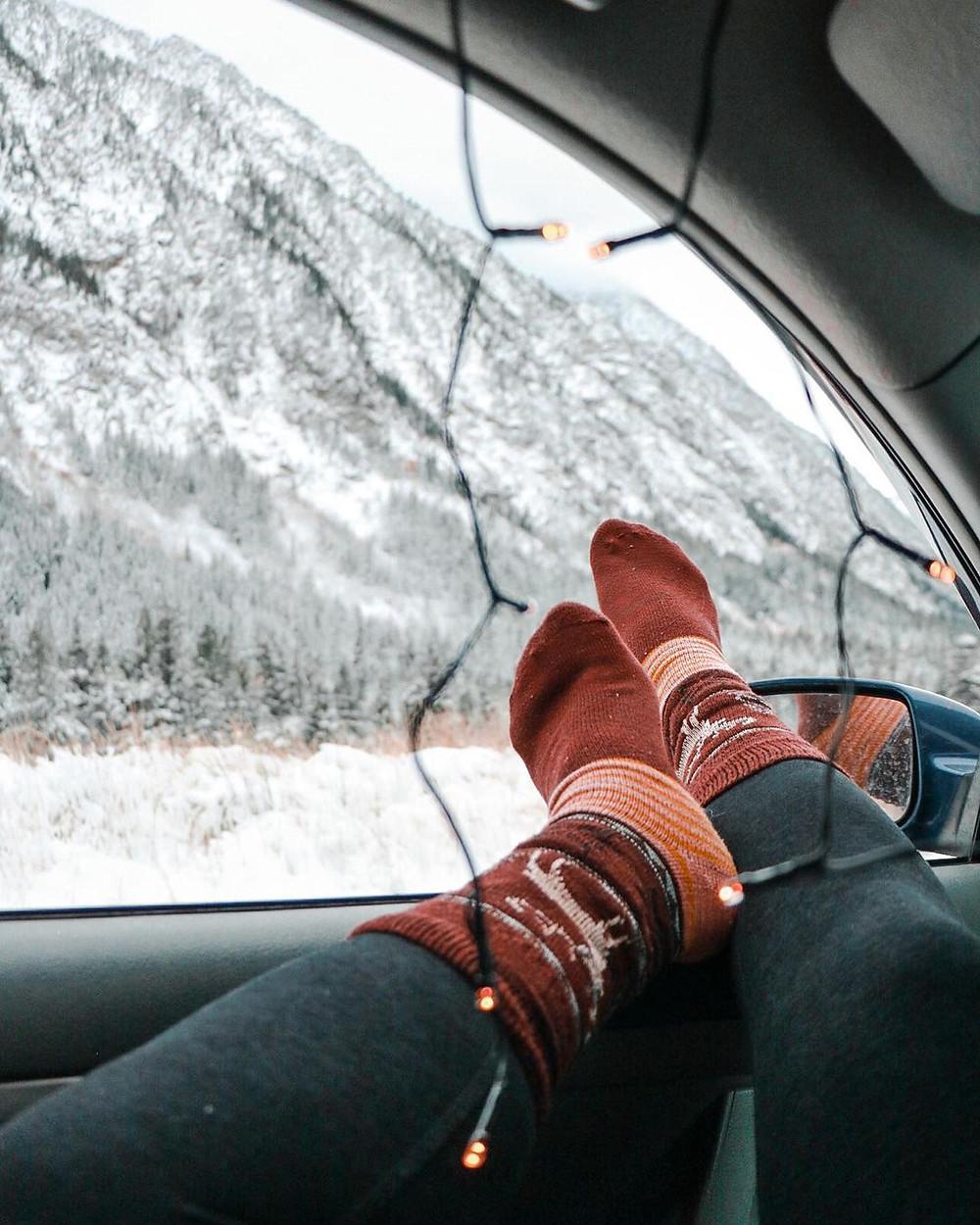 woman wearing leggings and socks in car