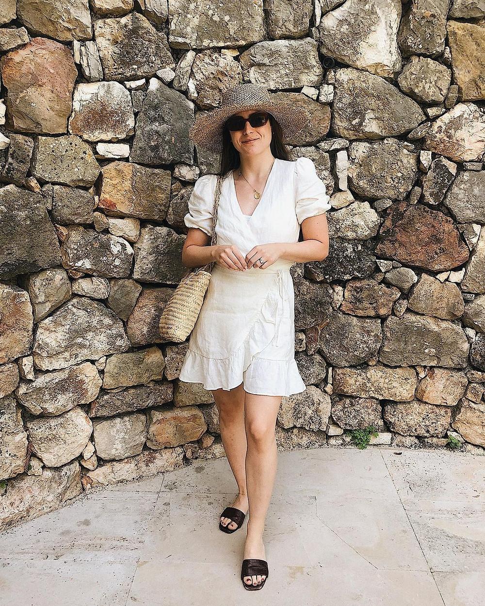 emily dawes wears a white linen dress in france