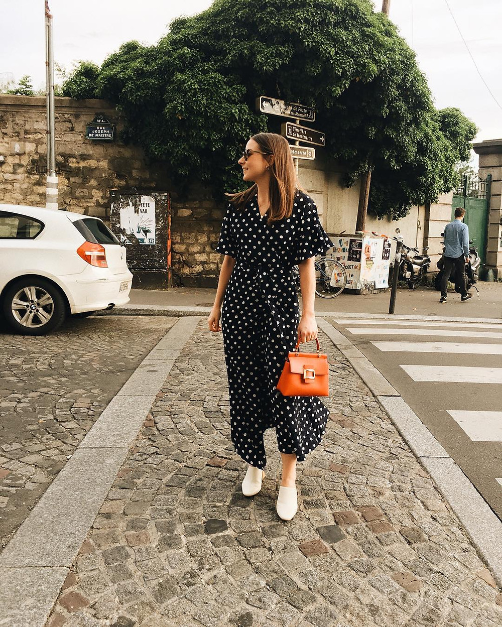 emily dawes wears spotted dress in paris
