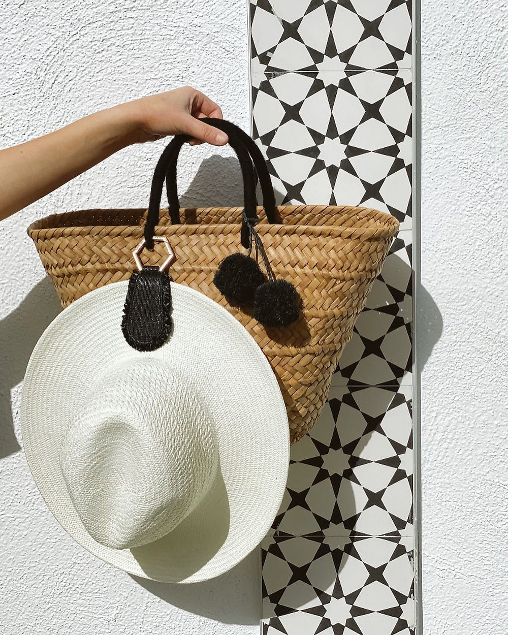 white hat and staw bag