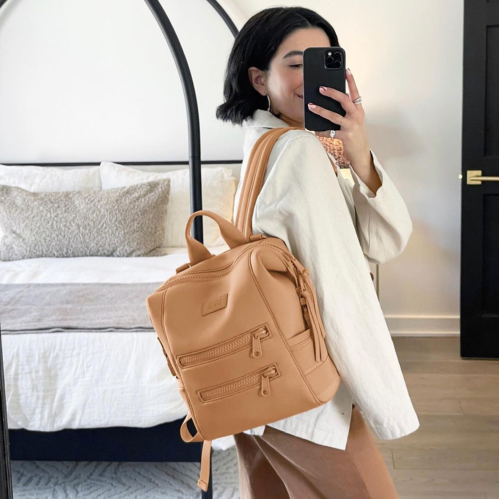 woman wearing dagne dover backpack