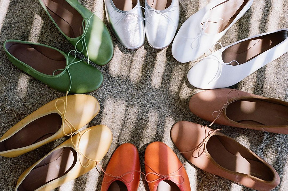 mansur gavriel ballet flats in green, yellow, orange, brown, white, and silver arranged in a circle