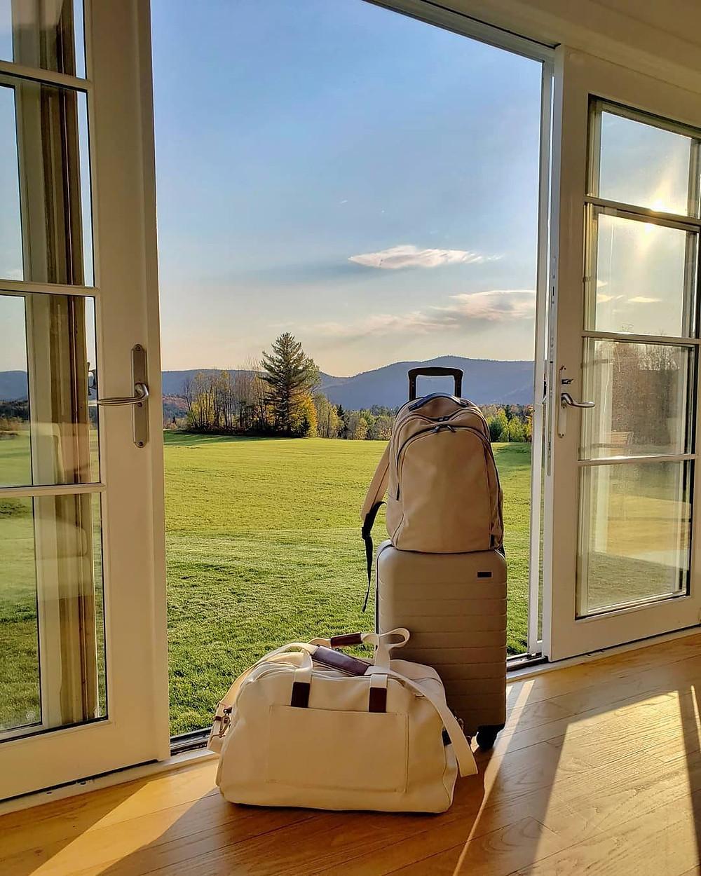 suitcases in door of house