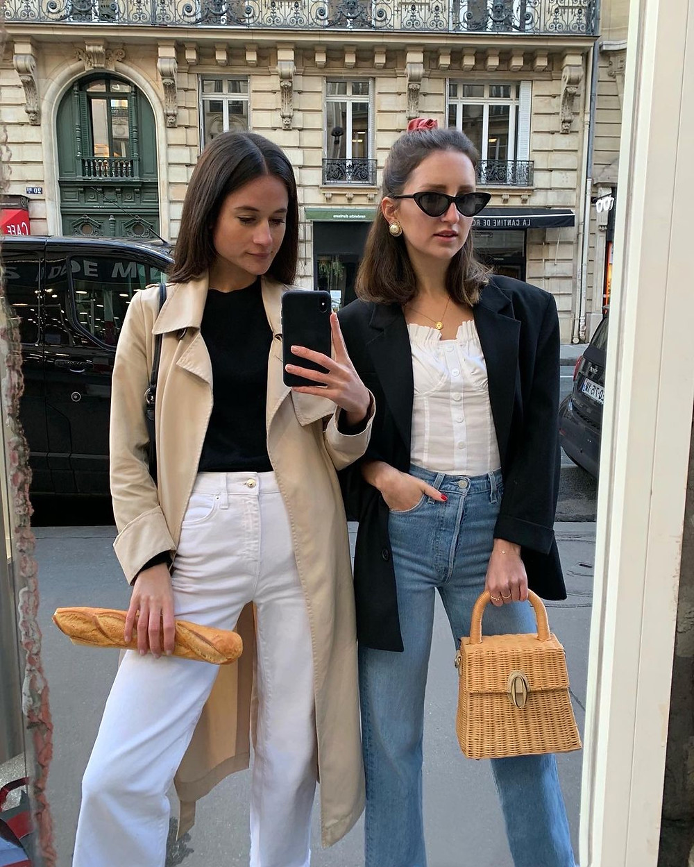 two stylish women in paris in light jackets and jeans