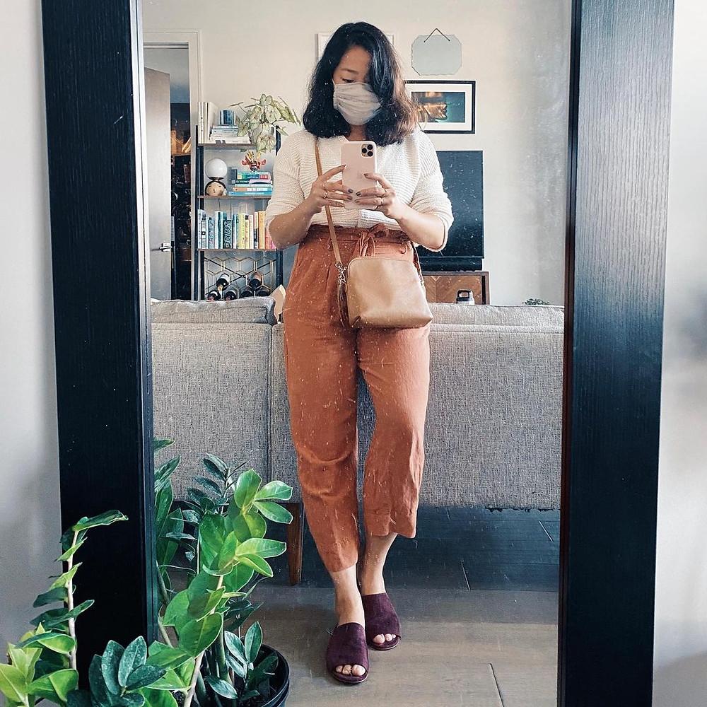women in SF taking mirror selfie