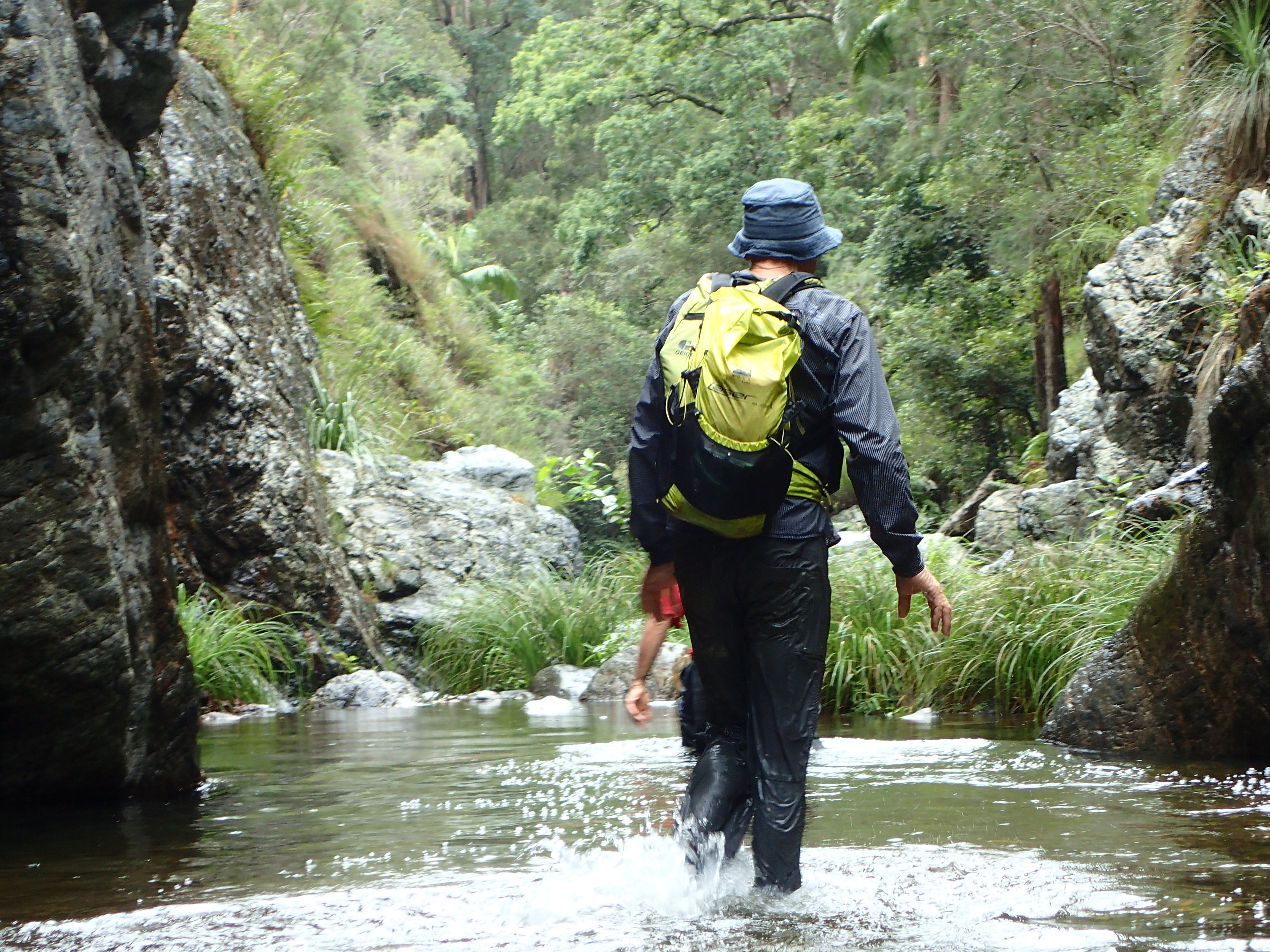 Kevin walking through a creek at Eagles Nest Queensland