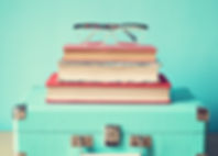hipster-and-retro-books-suitcase-and-gal