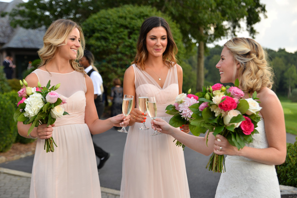 Bride and Bridesmades shairing a toast