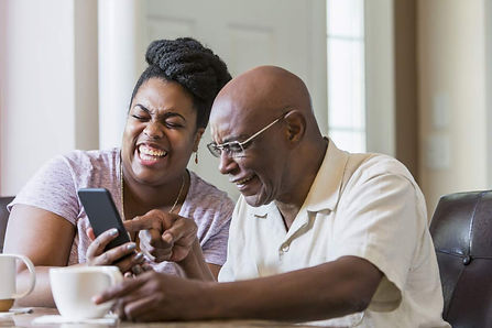 senior-man-and-daughter-laughing-at-smar