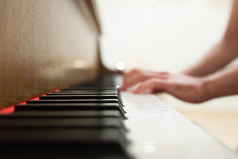 canva-person-playing-piano.jpg