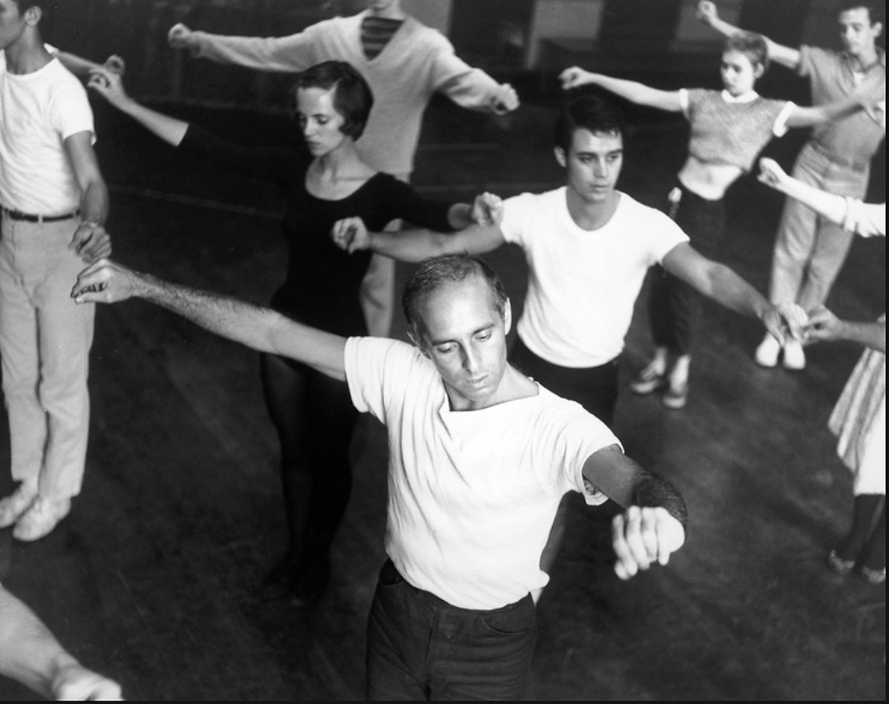 Choreographer Jerome Robbins, in white t-shirt directing male and female chorus members during a rehearsal of West Side Story in 1957.