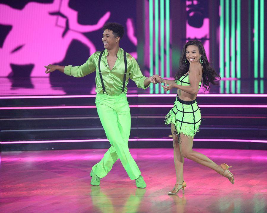 Jeannie Mai neon green skirt