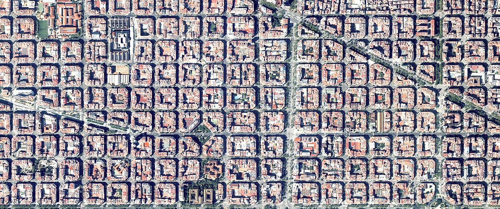 The aerial view of Barcelona's urban planning shows distinct octagonal intersections.