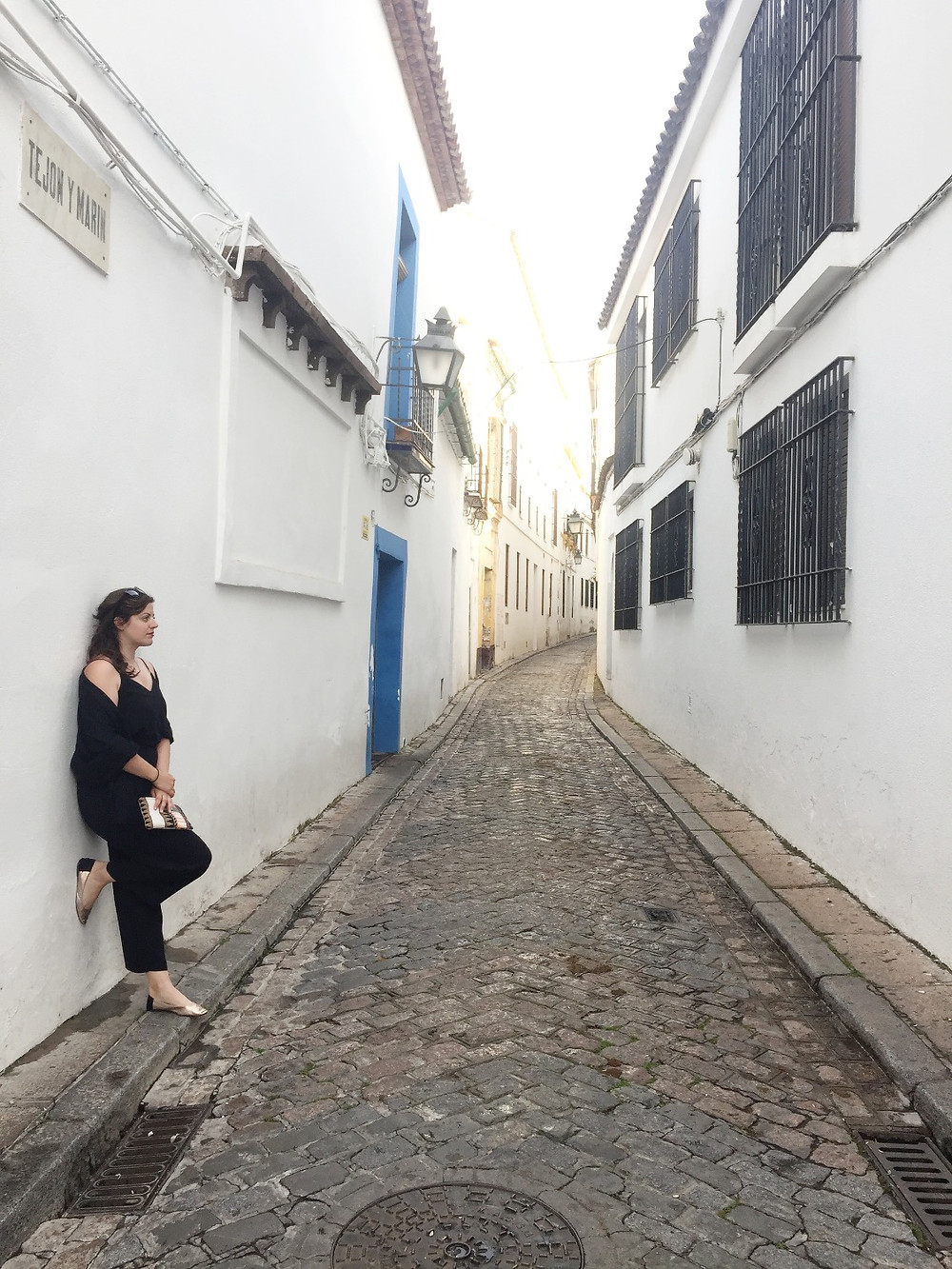 Narrow, white-washed cobblestone street in Cordoba.