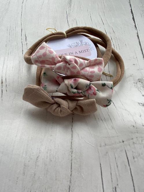3 pink hand tied, baby elastic headbands