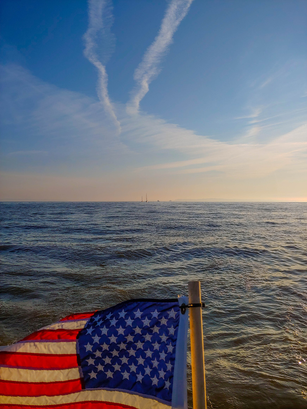 flag, american flag, water, calm, clouds, blue sky