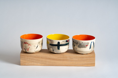 Wooden platter with three small bowls