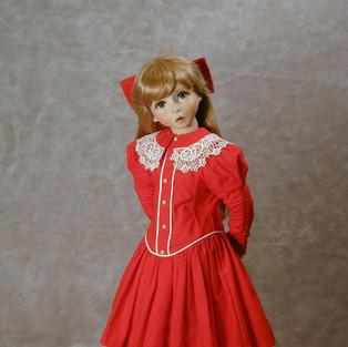 Original Porcelain wearing an original outfit.