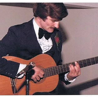 Most friends see this and express their amazement that I had all of that hair...and forget about my killer skills on the guitar. Oh well ... they both are distant memories now.
