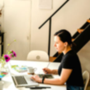 woman-in-black-crew-neck-t-shirt-sitting