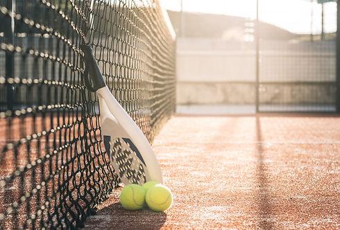 padel-blade-racket-resting-net_153437-13