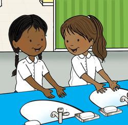 little girls washing hands