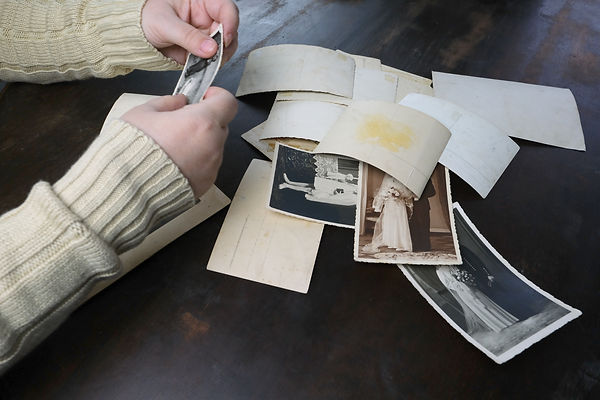 female hands fingering old photographs o